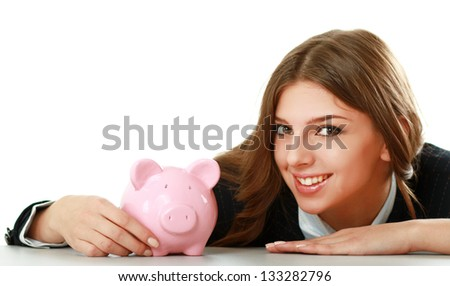 Young beautiful woman sitting with piggy bank (money box), isolated on white background