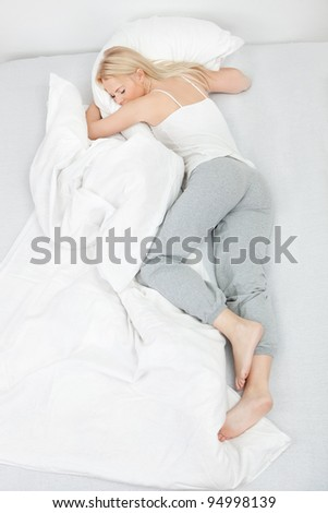 Young beautiful woman sleeping - stock photo
