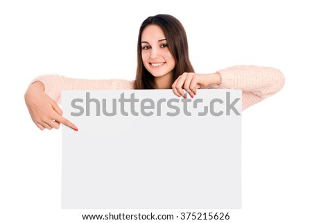 Young beautiful woman smiling showing blank white placard - stock photo