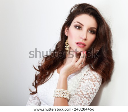 young beautiful woman studio portrait near white wall - stock photo