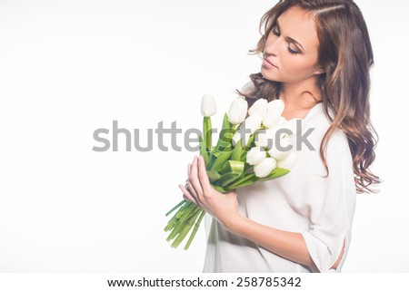 Young beautiful woman studio portrait with tulip flowers