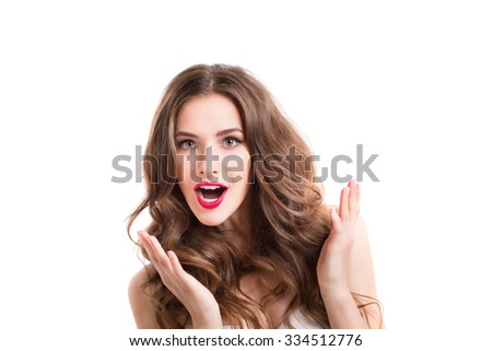 Young beautiful woman surprised. Curly Long Hair. Isolated on white background. - stock photo