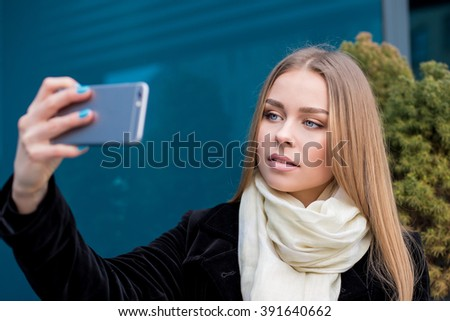 young beautiful woman taking selfie in the city - stock photo