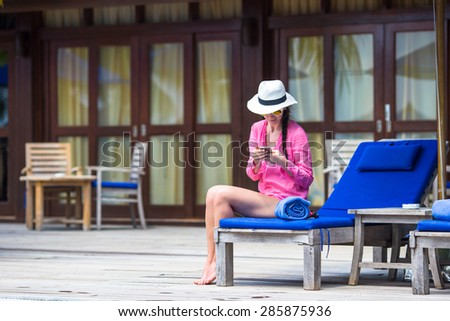 Young beautiful woman talking by phone  - stock photo