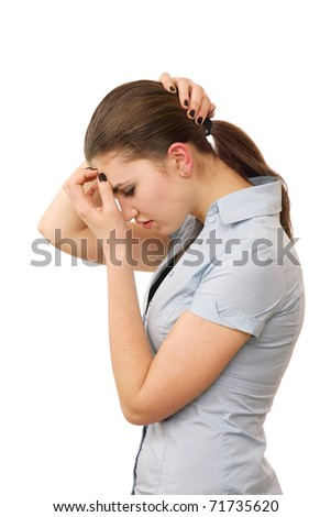 Young beautiful woman tests a headache against white background - stock photo
