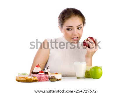 Young beautiful woman thinking about healthy and unhealthy eating