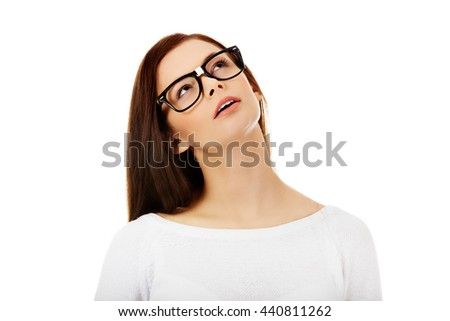 Young beautiful woman thinking looking up - stock photo