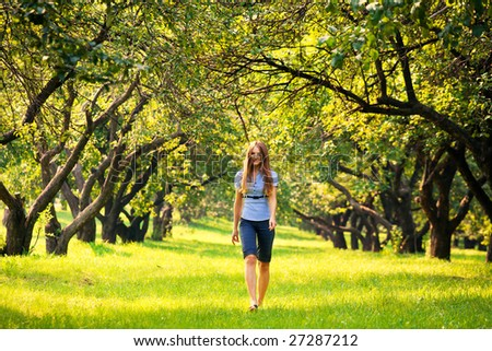 Young beautiful woman walking at park