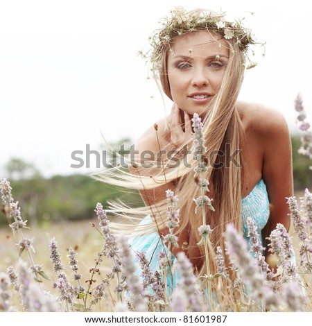 Young beautiful woman walking outdoors at summer - stock photo