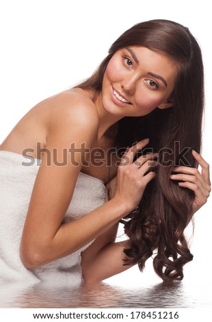 Young beautiful woman washing her long healthy hair in water. Isolated on white background - stock photo