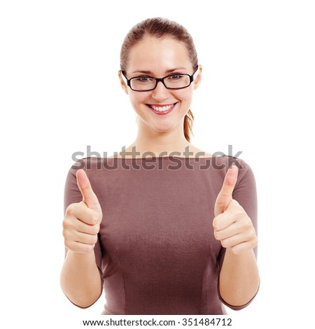 Young beautiful woman wearing black glasses and brown dress showing thumb up hand gesture with both hands and smiling isolated on white background - success concept - stock photo