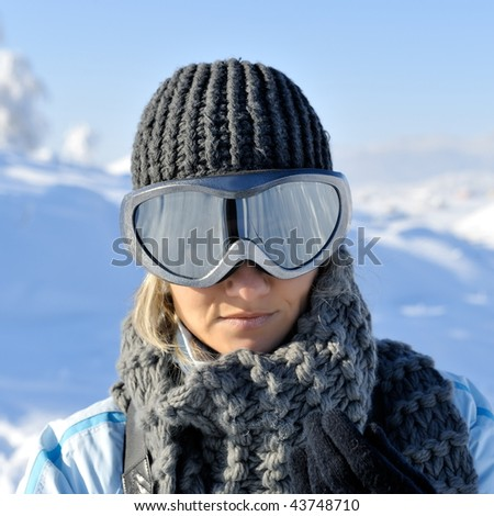 young beautiful woman wearing ski glasses - stock photo
