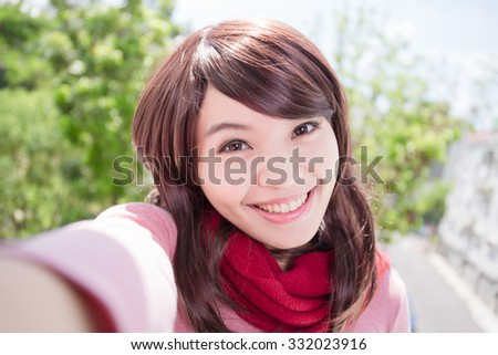 Young beautiful woman wearing winter clothing and photo selfie, asian beauty - stock photo