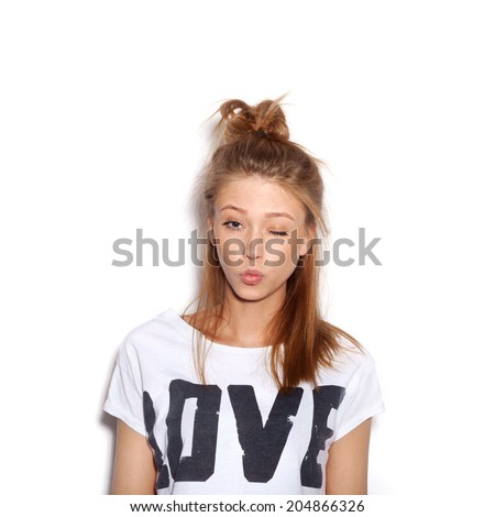 Young beautiful woman winking . White backgroung, not isolated - stock photo