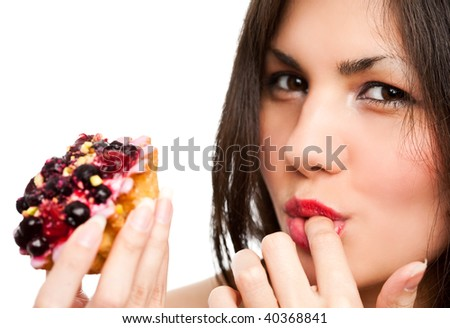 Young beautiful woman with a cake. Close-up studio portrait. isolated on white
