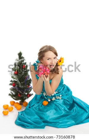 Young beautiful woman with a Christmas gift.
