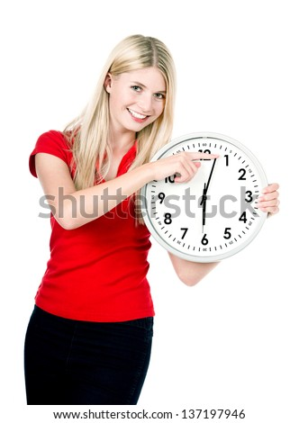 young beautiful woman with a clock isolated on white background. time management concept