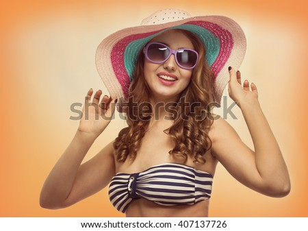 Young beautiful woman with a hat in the hot summer - stock photo