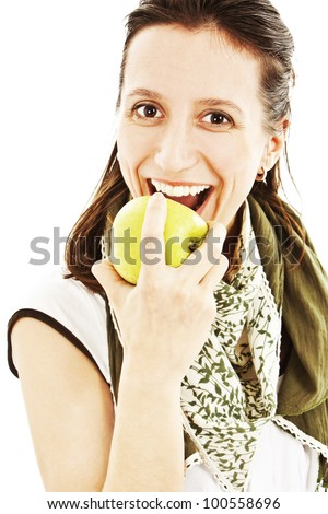 Young beautiful woman with an apple looking towards camera Isolated on white background. - stock photo