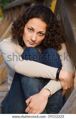 Young beautiful woman with arms crossed