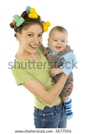 Young, beautiful woman with baby on hands. Smiling and looking at camera