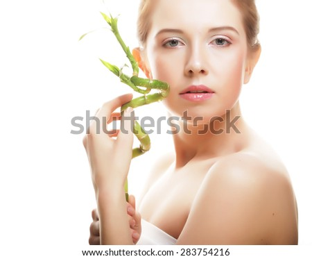 young beautiful woman with bamboo isolated on white