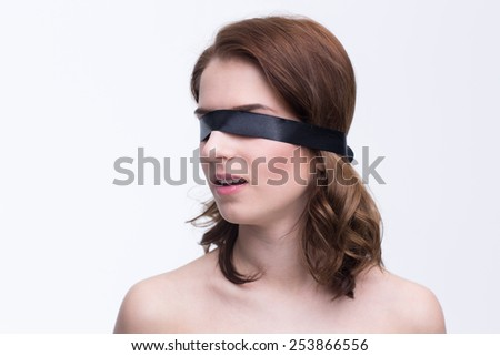 Young beautiful woman with black blindfold - stock photo