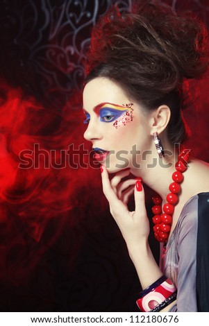 Young beautiful woman with bright make up