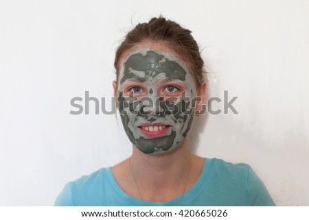 Young beautiful woman with clean skin make a mask for fresh faces applying Face Cream. Youth and Skin Care Concept. Spa and Wellness. domestic procedure. getting facial mask