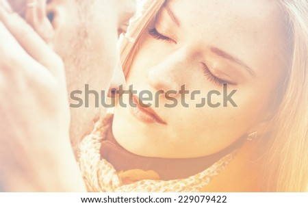 Young beautiful woman with closed eyes embraces a man, tenderness scene. Close-up image