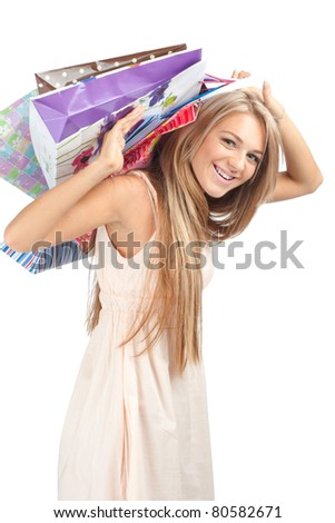 Young beautiful  woman with colorful shopping bags in her hands