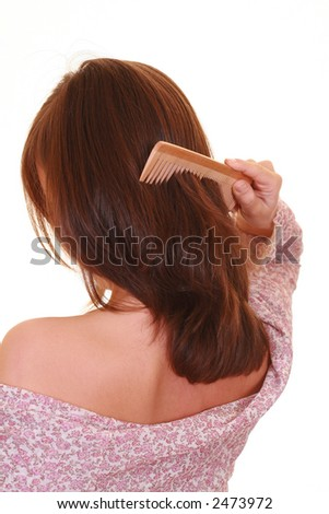 young beautiful woman with comb isolated on white - stock photo