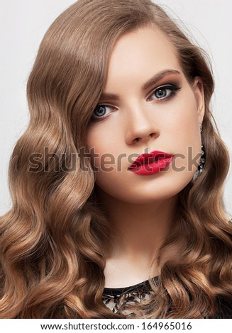 Young beautiful woman with curly hair and make-up