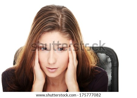 Young beautiful woman with depression, isolated - stock photo