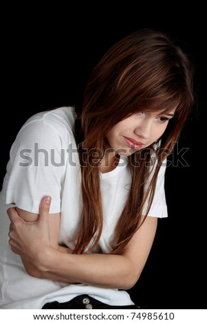 Young beautiful woman with depression isolated on black - stock photo