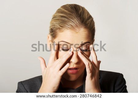 Young beautiful woman with eyes pain - stock photo