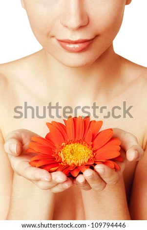 young beautiful woman with flower - stock photo
