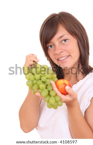 young beautiful woman with fresh grapes and peach isolated on white - stock photo