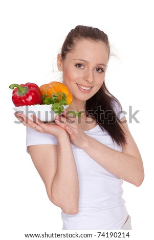 Young beautiful woman with fresh vegetables on a white background. Concept of healthy food.