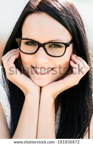 Young beautiful woman with glasses - outdoor portrait