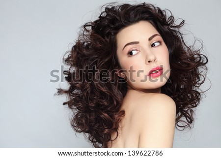 Young beautiful woman with gorgeous long curly hair