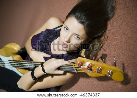 young beautiful woman with guitare - stock photo