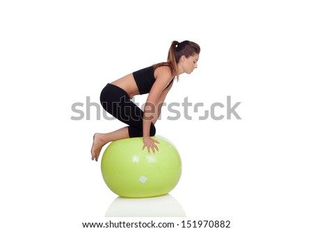 Young beautiful woman with gymnastic ball on a white background. - stock photo