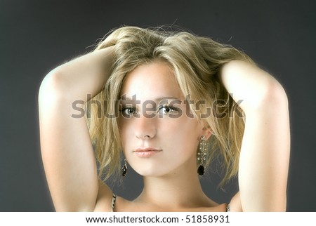 young beautiful woman with hands in hair - stock photo