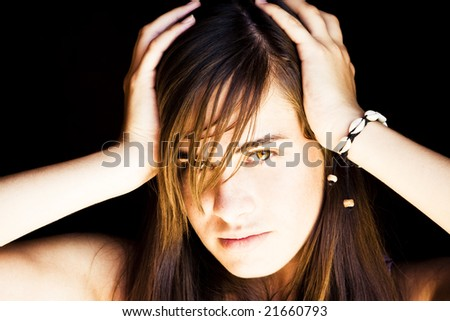 Young beautiful woman with hands in head. - stock photo