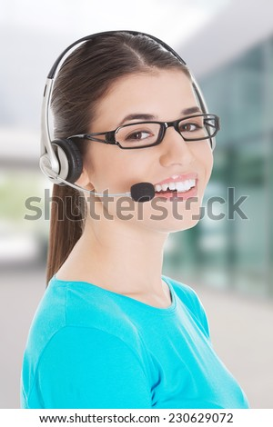 Young beautiful woman with headphones and microphone - stock photo