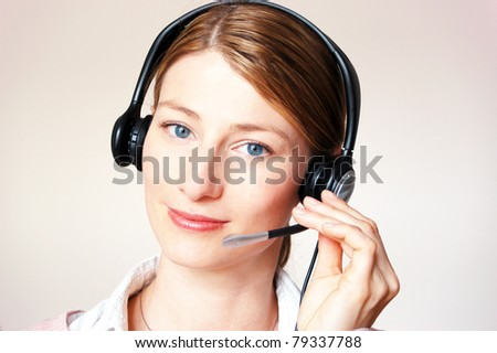 Young beautiful woman with headset - stock photo
