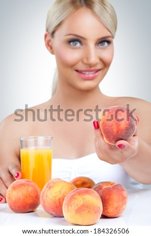 Young beautiful woman with healthy fresh juice  - stock photo