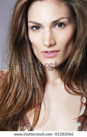 Young beautiful woman with healthy long hair.
