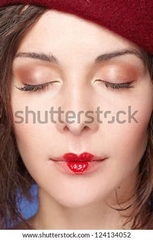 young beautiful woman with heart drawing on lips with close eyes. Valentine's day